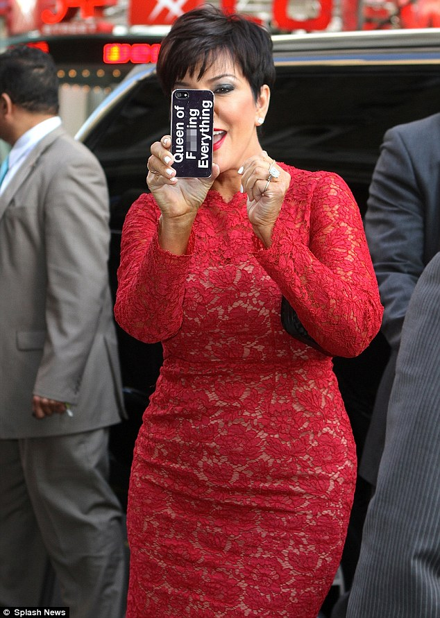 Having a laugh: The matriarch played with onlookers as she flaunted the printed message for all to see