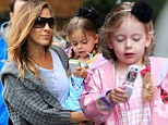 They must have a great family plan! Sarah Jessica Parker and Matthew Broderick give the twins toy cell phones en route to school