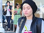 One cool customer! Miley Cyrus dresses down to pick up a frozen yoghurt treat with her friend