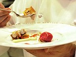 French chef Daniel Boulud shows off one of his specialties in the kitchen at his flagship restaurant, Daniel, in New York