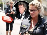 Make-up free Rachel Hunter squeezes in a Pilates workout as ex-Rod Stewart pours out his heart over their 'earth-shattering' divorce in TV interview