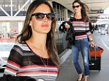 Staying under wraps! Alessandra Ambrosio hides her perfect figure in baggy boyfriend jeans