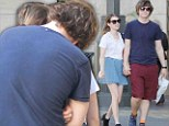 The sweetest thing! Emma Roberts and her boyfriend Evan Peters kiss as they head to the cupcake counter