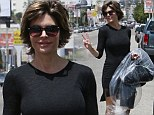 It's all good: Lisa Rinna throws up a peace sign after a confrontational episode of Celebrity Apprentice