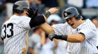 Russell Martin #55 of the New York Yankees is congratulated by teammate Nick Swisher #33 on his grand slam home run in the sixth inning against the Oakland Athletics on August 25, 2011 at Yankee Stadium in the Bronx borough of New York City. (Photo by Chris Trotman/Getty Images)