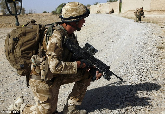 On patrol: A British soldier from A Company, 2 Mercian in the Babaji village in Helmand