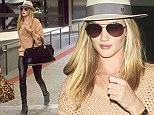 Rosie arrived at LAX looking a picture of perfection