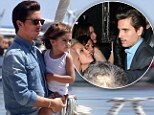 Back on daddy duty! Scott Disick cuddles up to son Mason in Greece... just 36 hours after partying the night away in London club