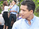 School reunion! Leah Remini pinches old Saved By The Bell co-star Mario Lopez' cheeks on set of Extra