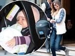 Making it look easy: Gisele Bundchen manages to be chic and comfortable as she transports blue-eyed baby Vivian