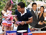Everyone loves candy bars! Mario Lopez brings daughter to Nestle Crunch's 75th birthday