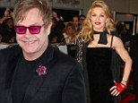 Making good: Sir Elton John sent Madonna an apologetic note over dinner in France after a decade of insults