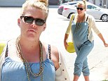 Heavily pregnant Busy Philipps slips into old maternity favourite of dungarees as she mulls over baby names