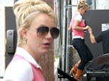 Should have worn flats! Britney Spears gets a helping hand as she teeters into the recording studio in high heeled boots