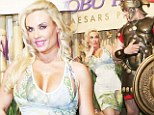 Won't Ice-T be jealous? Coco Austin gets flirty with a Roman while parading her sexy curves in floral frock at Las Vegas party