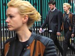 Peas in a pod! Carey Mulligan and Marcus Mumford hold hands as they go for stroll in New York