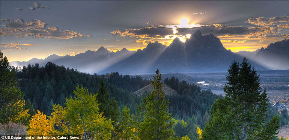 Nature: Mountains stand against the sunset over Grand Teton National Park in Wyoming