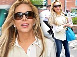Buy my booze! Adrienne Maloof flashes a bottle of her cupcake-flavoured vodka as she steps out for lunch