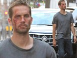Taking a beating! Paul Walker reveals a bloodied face as he and the cast of Brick Mansions begin filming