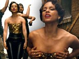 A golden performance! Alicia Keys shows off her physique in low cut bustier in New Day video