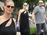 A tad revealing! Heidi Klum goes braless in racy black frock for shopping trip with boyfriend Martin Kristen