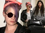 Kelly Osbourne and Matthew Mosshart hold hands as they head through the airport after keeping coy on engagement rumours