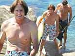 Former gold medalist Bruce Jenner, 63, shows off a more wrinklier physique as he goes paddle boarding with muscular sons Brandon and Brody