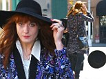 Hipster hazard: Florence Welch and her giant hat almost blow away in New York