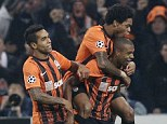 Star man: Fernandinho (right) has shone for Shakhtar