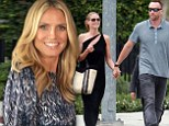 'I am not engaged': Heidi Klum claims she is 'not planning to get married anytime soon' despite stepping out in matching rings with boyfriend Martin Kristen