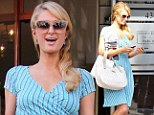 Like that French city in springtime! Paris Hilton looks lovely in a striped powder blue dress