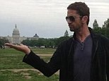 A touch of comedy: Gerard Butler holds 'Washington' in the palm of his hand, in a Twitter post on Tuesday