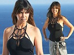 Move over Kim! Kourtney Kardashian turns heads as she showcases her curves in black keyhole swimsuit on Greece getaway