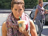 Ashley Tisdale drinks a cold coffee in Los Angeles, California