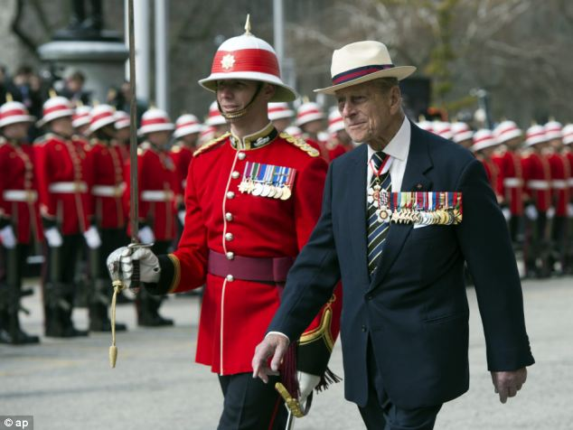 Prince Philip inspects an honour guard from the 3rd Battalion of The Royal Canadian Regiment