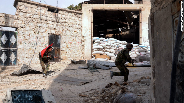 Syrian army soldiers run for cover during clashes with rebel fighters at Karam al-Jabal neighborhood of Aleppo on October 20.