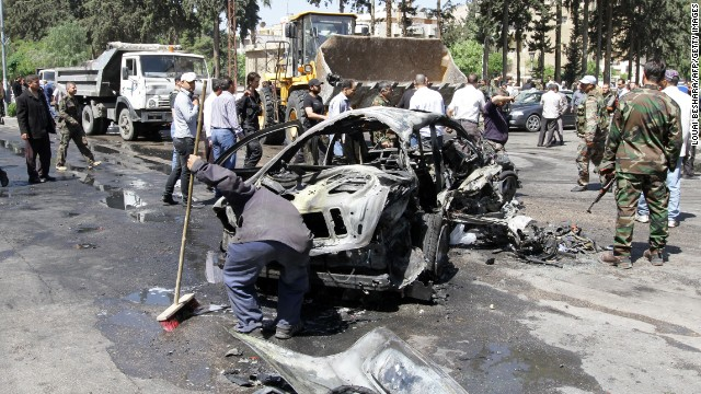 Cleaning takes place following another explosion in an upscale Damascus neightborhood on Monday, April 29. Syrian Prime Minister Wael al-Halqi survived the bombing targeting his motorcade.