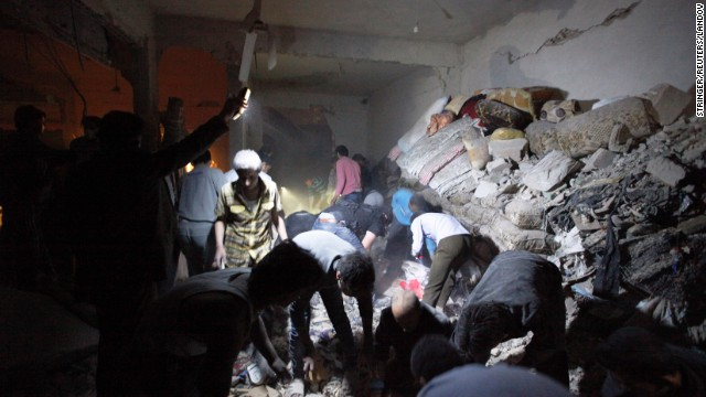 Searchers excavate rubble in a building damaged by what activists say was a missile attack from the Syrian regime in Raqqa province, Syria on April 25.