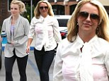 Forget to bring a replacement? Britney Spears flashes pink sports bra in sheer blouse after changing out of fitness gear