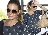 She's a star! LeAnn Rimes shows off her celestial body as she jets off to meet Eddie Cibrian
