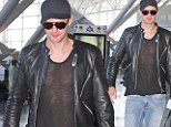 Alexander Skarsgard departs out of JFK