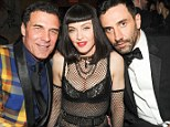 Material girl: Madonna, sat between Andre Balazs and Riccardo Tisci, unveiled her daring punk outfit at the Costume Institute Gala After Party at the BOOM BOOM Room in New York, on Monday