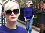 Newly blonde Anne Hathaway walks her dog Esmeralda following her exciting night at the Met Ball