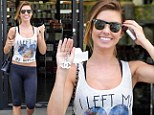 'I left my heart in Indio!': Audrina Patridge pines for Coachella as she displays her flat stomach in a midriff-baring top paired with skintight leggings