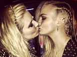 What drug scandal? Cara Delevingne, seen here locking lips with Sienna Miller, certainly didn't let an alleged drug scandal get in the way of her good time at the Met Ball in New York Monday