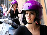 Glamour scoot! Jake Gyllenhaal's 'beau' Emily DiDonato rides a motorbike in a chic black dress for make-up commercial