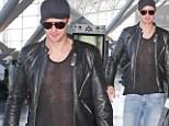 Alexander Skarsgard departs out of JFK