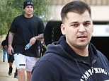 He not usually so shy: Reality star Rob Kardashian 'steals a photographer's camera equipment after being snapped shirtless'