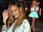 Showing Chris what he's missing! Rihanna flaunts her assets in unbuttoned shirt and TINY skirt as she exits New York hotel