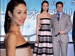 Olga Kurylenko dispels a common myth as she proves horizontal stripes do NOT make you look bigger